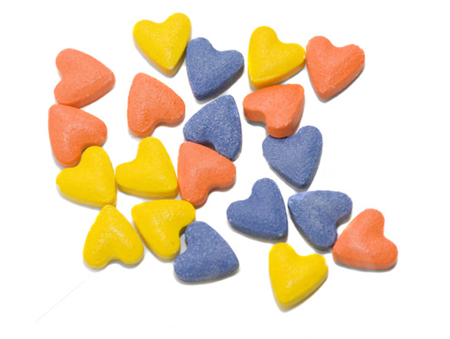 Большинство витаминов для кошек имеет форму сердец или гранул